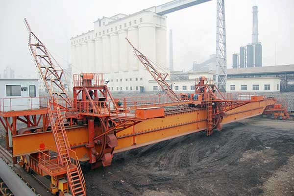 Bridge type bucket wheel stacker reclaimer.