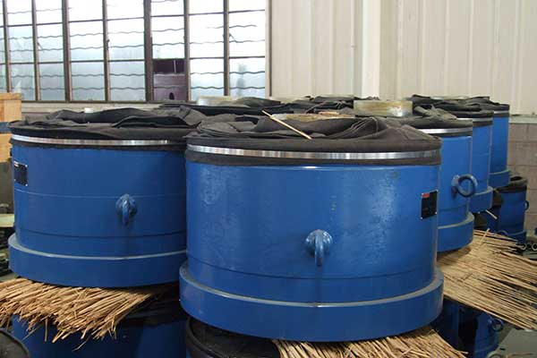 The oil cylinders of hydraulic cement roller press.